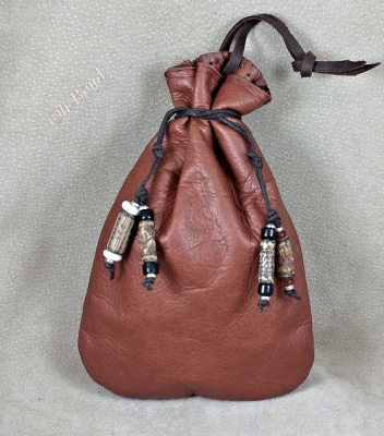 A hand stitched double drawstring pouch with beads from our woods.