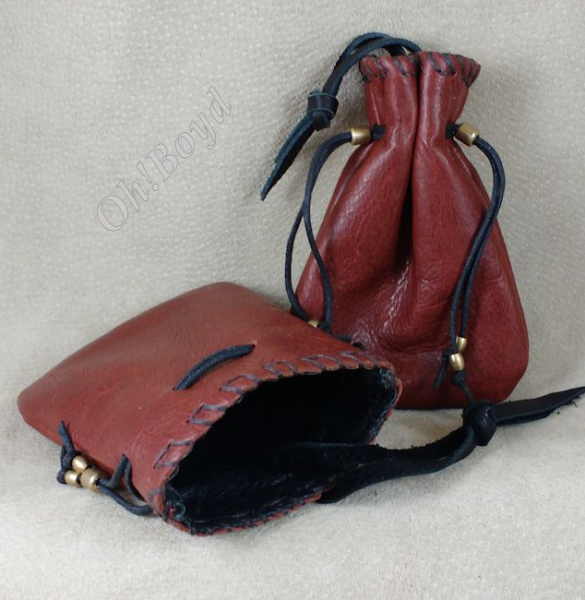 Leather lined, lint-free leather pouches for tobacco, electronics, money, more.