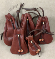 Tobacco color small leather bags.