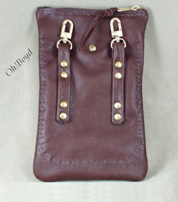 A zippered leather hip bag that clips onto the matching keepers on your belt.