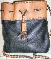 Braided drawstring and shoulder strap, a combination of machine and hand sewing, and copper beads.