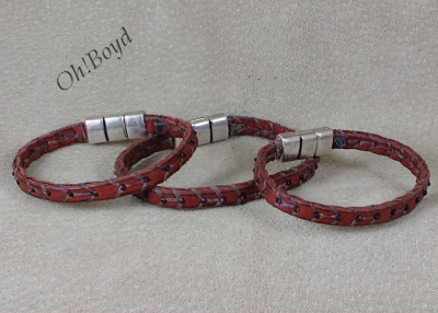 Hand stitched leather bracelet bands with silver bead inlays.