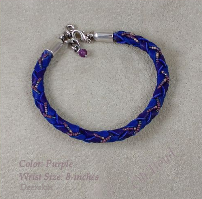 Purple deerskin round braid bracelet with tiny seed beads fits up to 8-inch wrist.