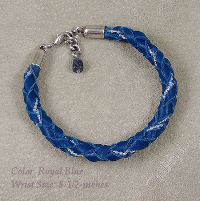 Graceful blue leather bangle bracelet fits up to 8-1/2-inches.