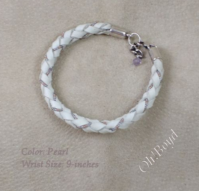 This pearl white graceful leather bangle bracelet fits up to 7-1/2-inches.