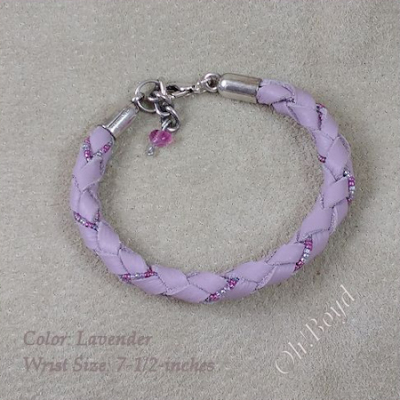 This lavender graceful leather bangle bracelet fits up to 7-1/2-inches.
