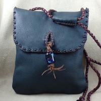 Adjust strap to wear as shoulder or cross-body bag, hand bag, or waist or hip bag.
