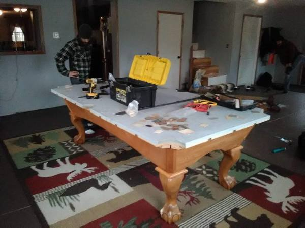 Pool Boss LLC Leveling a table