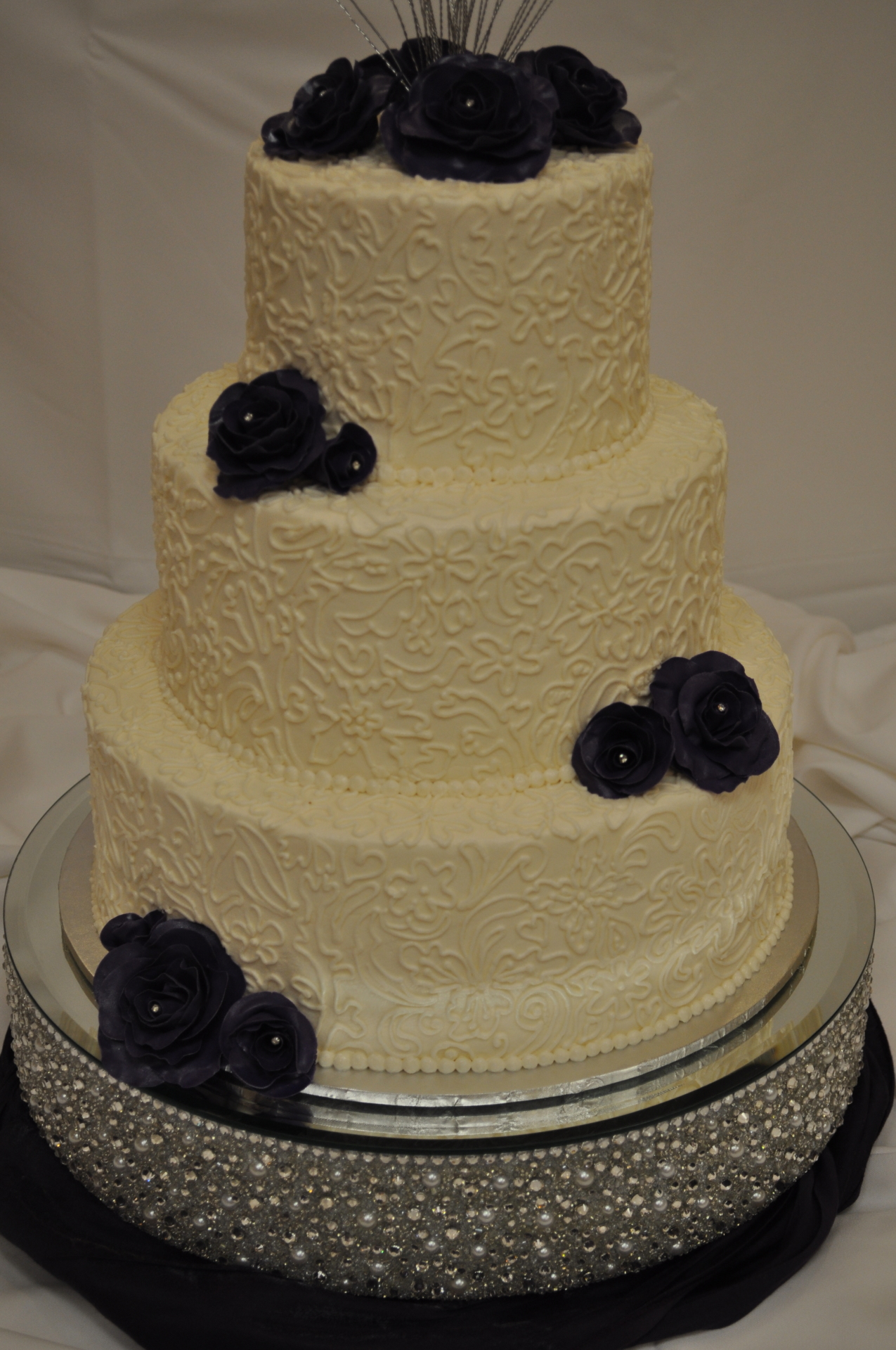 Ivory freehand piped lace with purple sugar roses