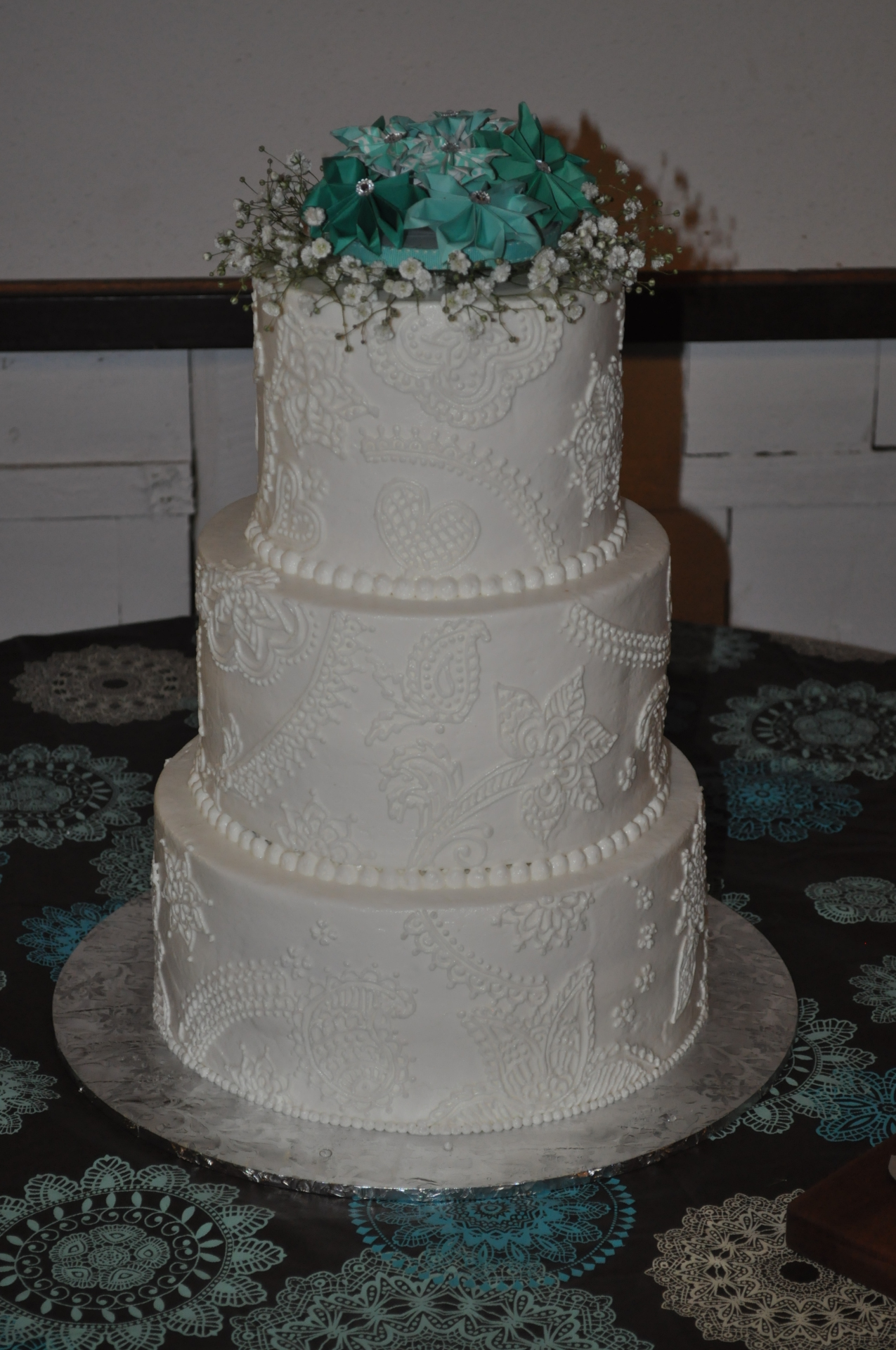 White henna with teal non edible flower topper