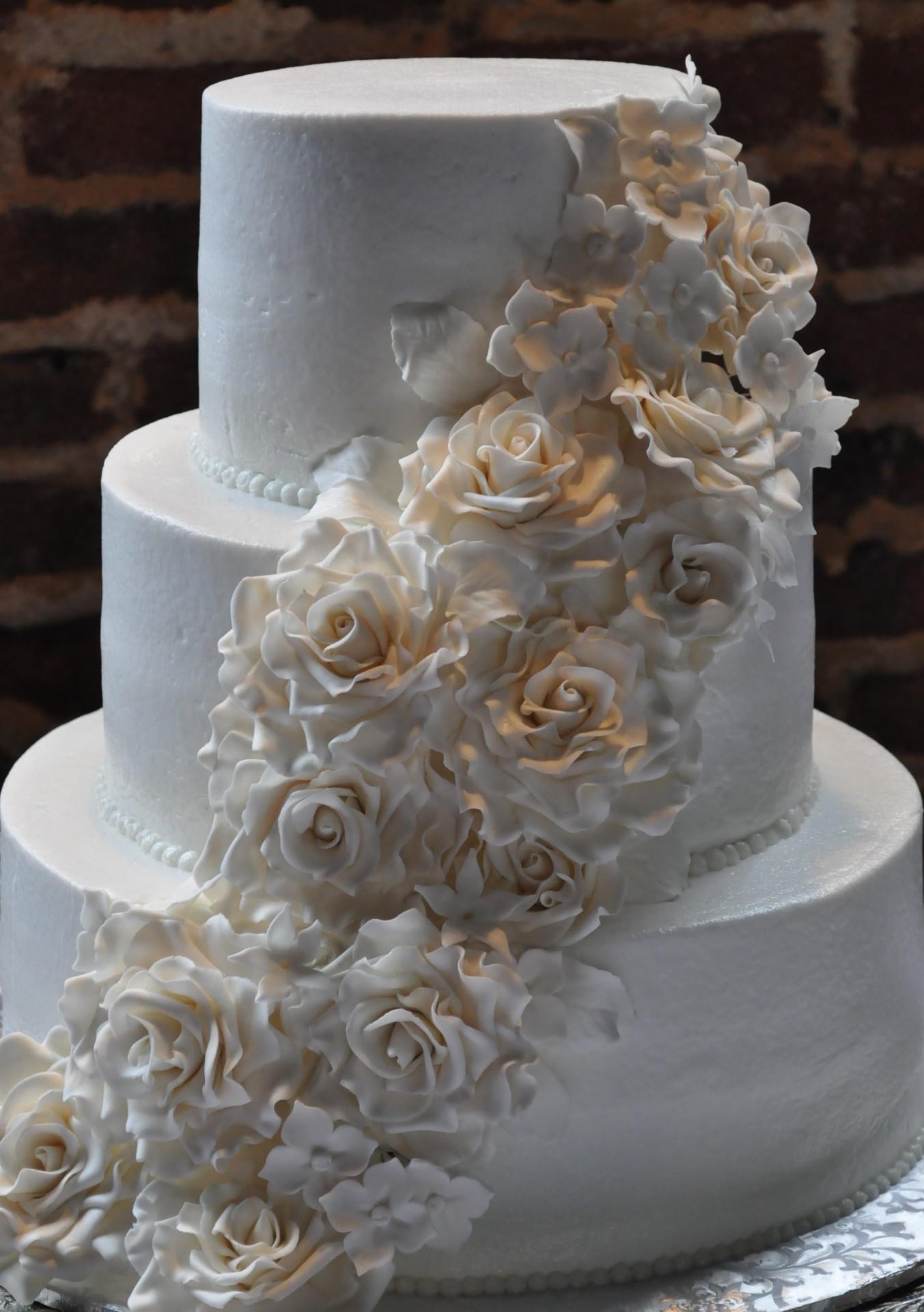Cascading white sugar roses