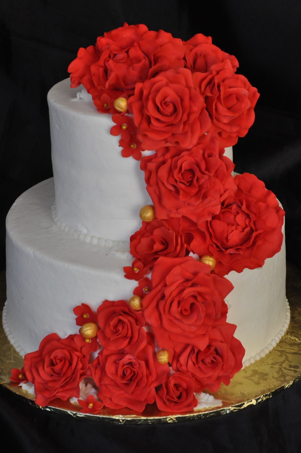 Cascading red sugar roses