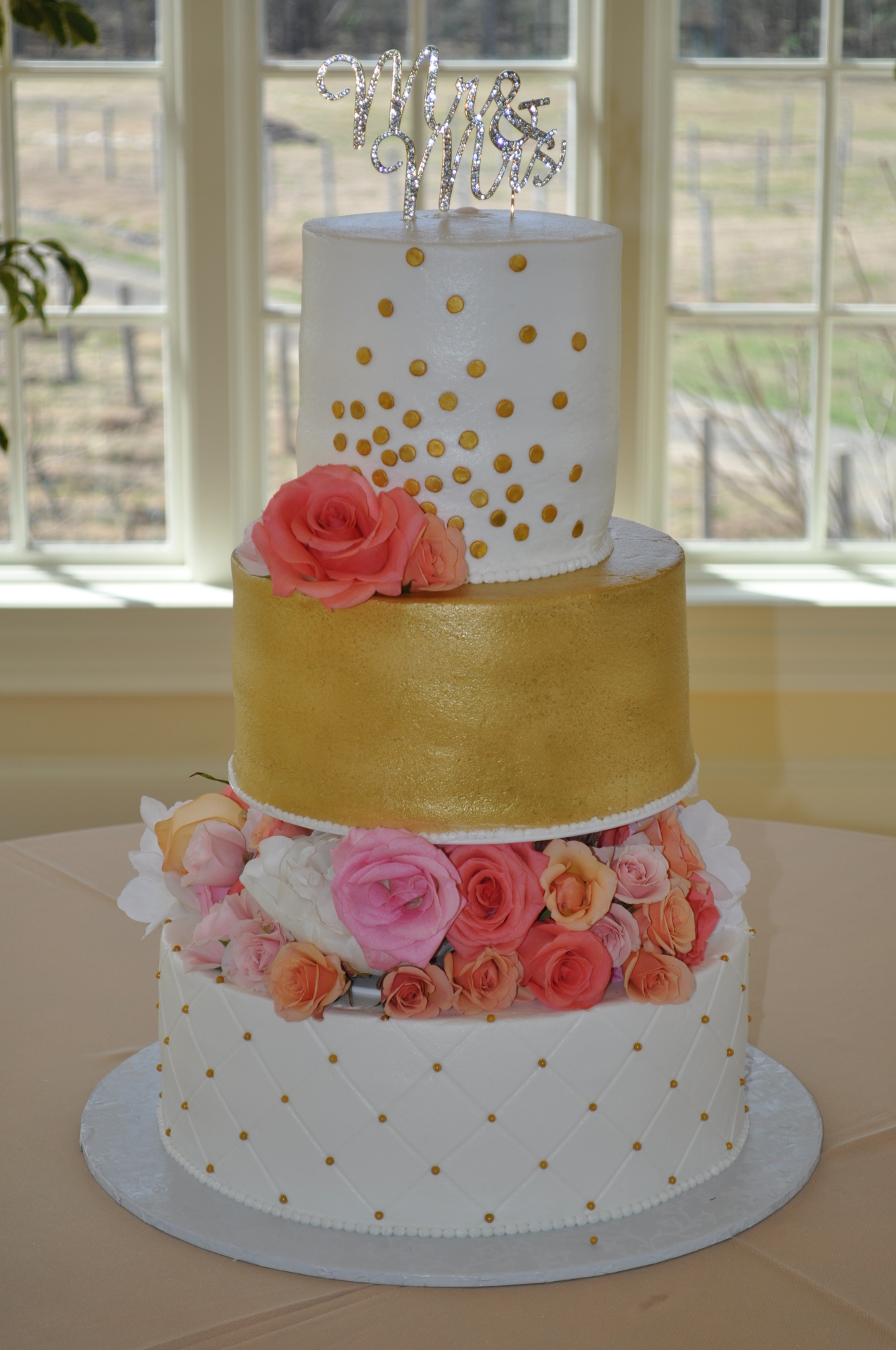 Gold and white tiers with flower spacers