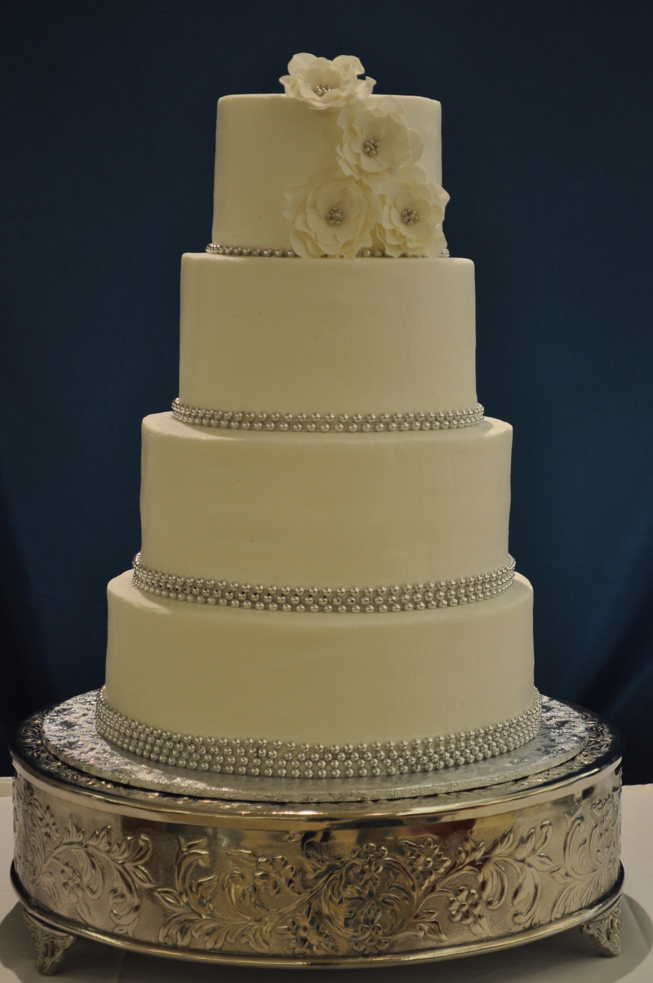 Buttercream perfection with silver bead border