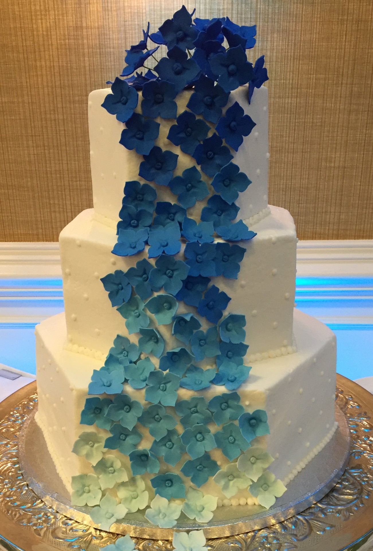 Hexagon tiers with cascading ombre blue hydrangeas