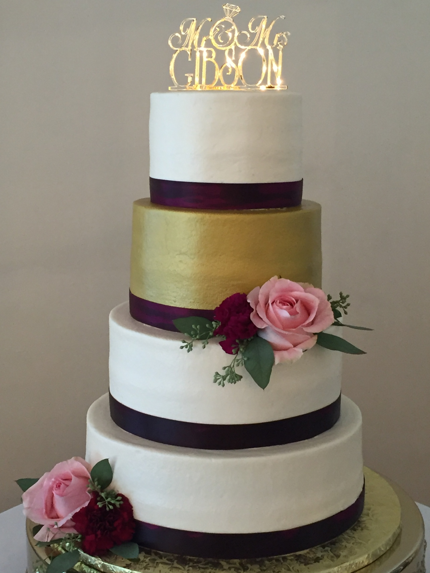 White buttercream and a Gold tier