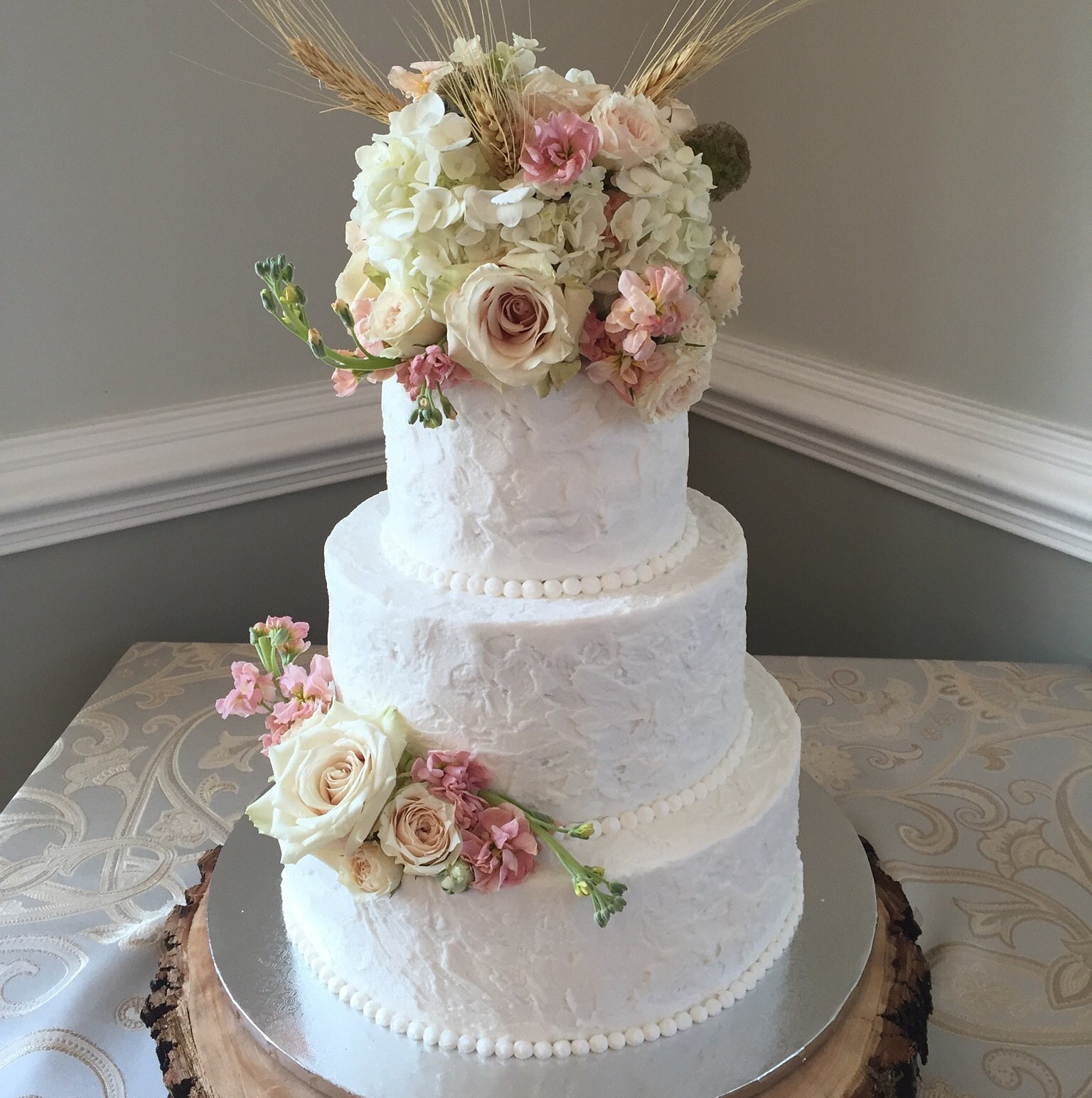 Rustic buttercream and fresh flower topper
