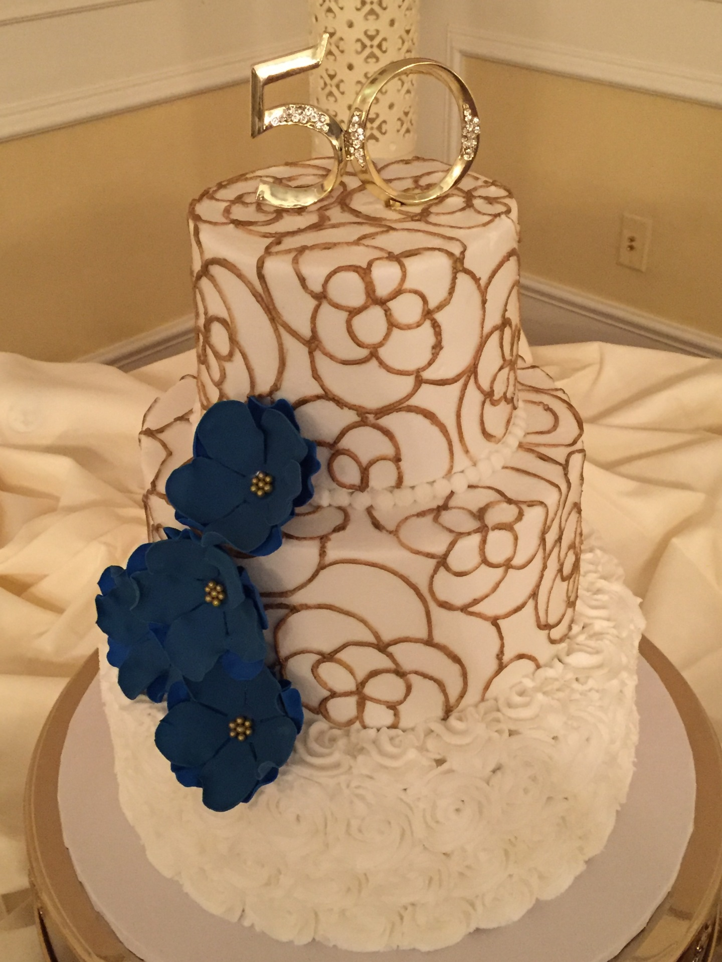 Gold piping with blue sugar flowers