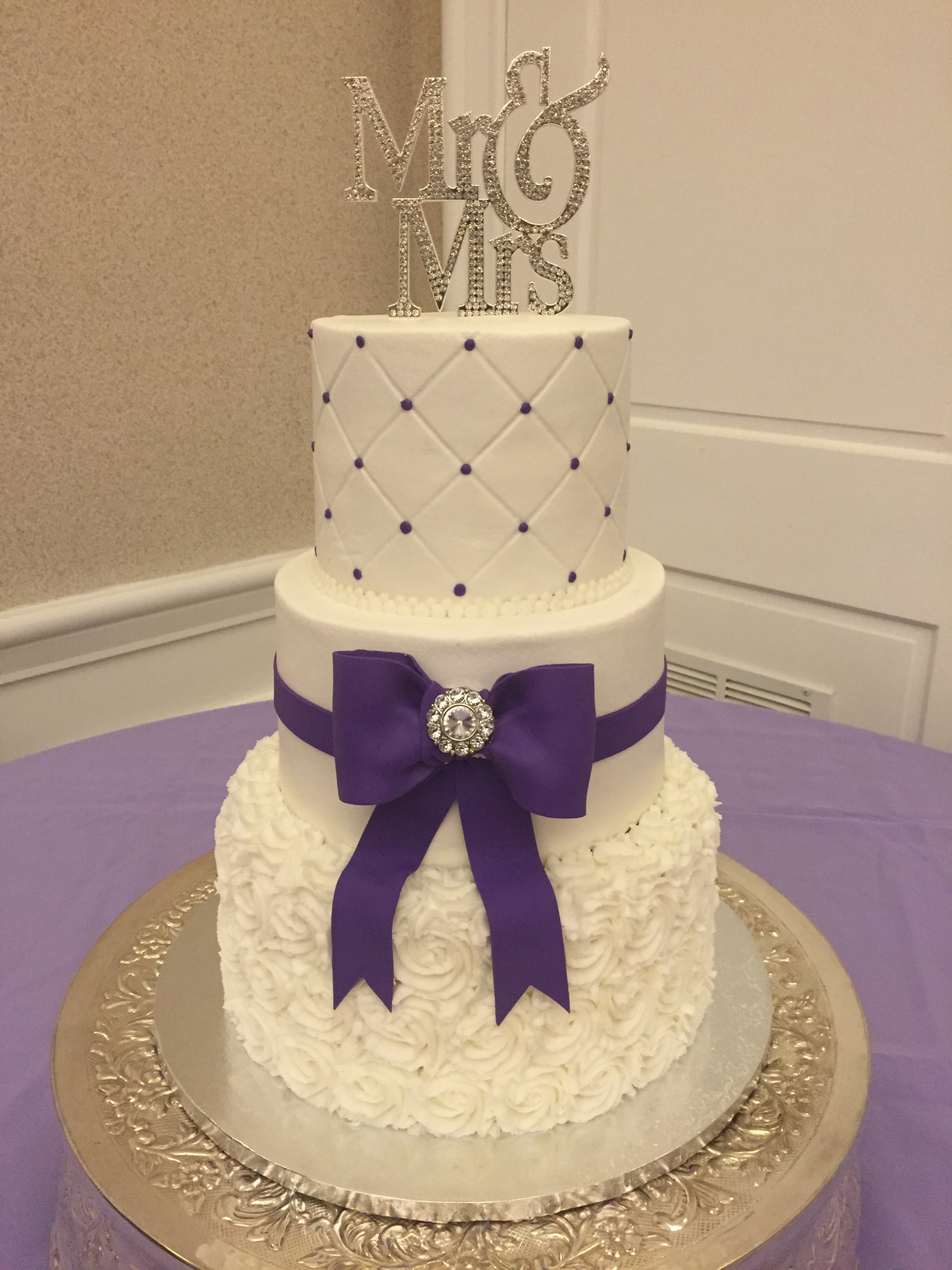 White rosettes and purple bow