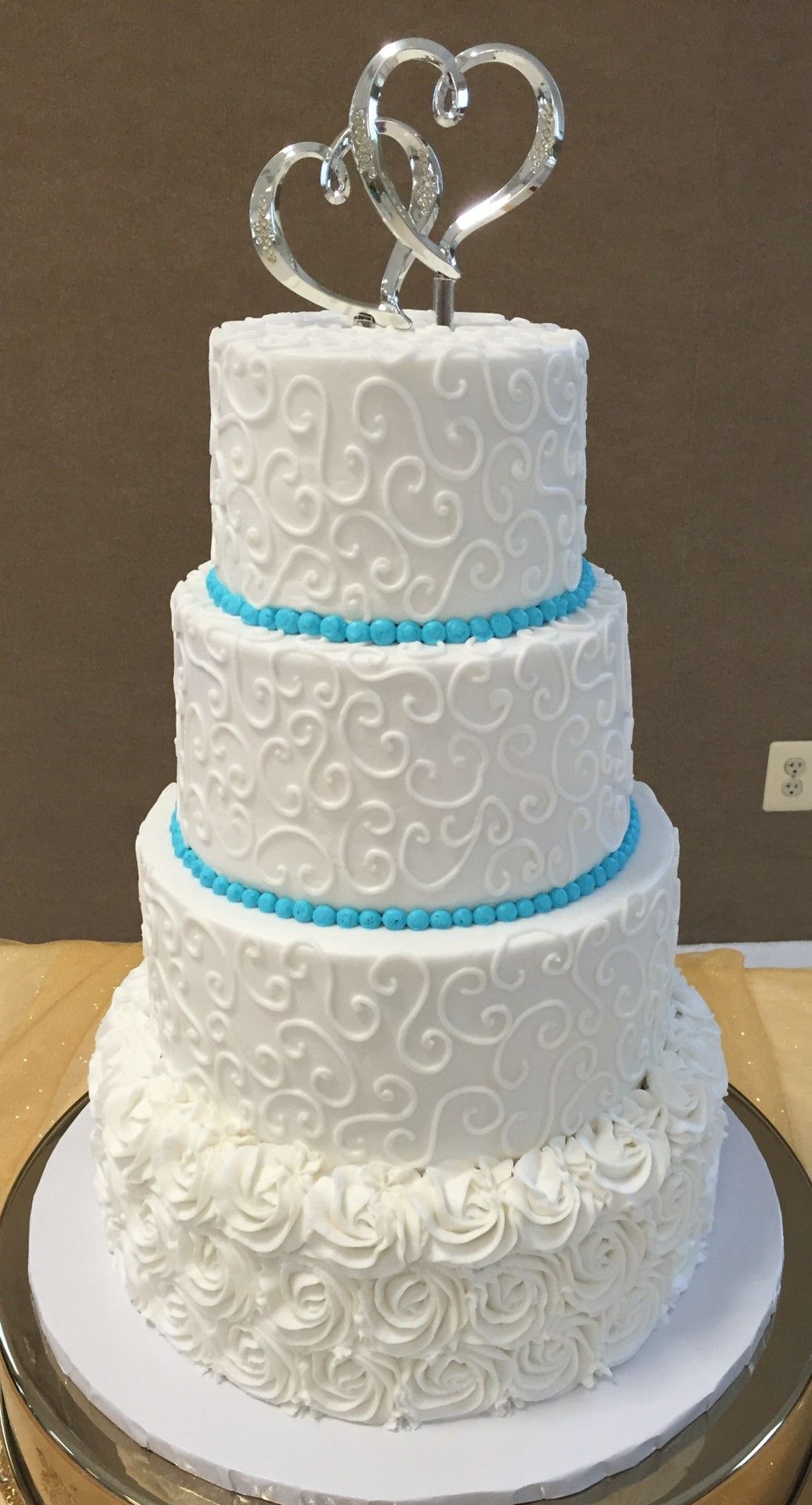 White rosettes and blue borders 4 tier