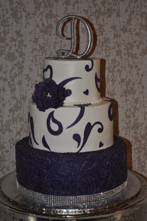 Royal purple brush embroidary and cutout scrolls