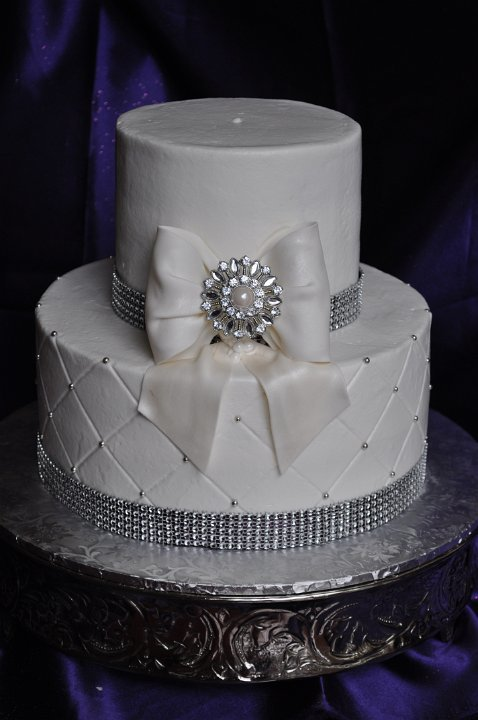 2 tier glam bow and brooch