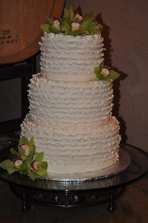 Fondant ruffles and fresh orchids