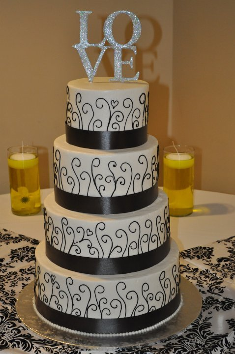 Black upright scrolls and ribbons