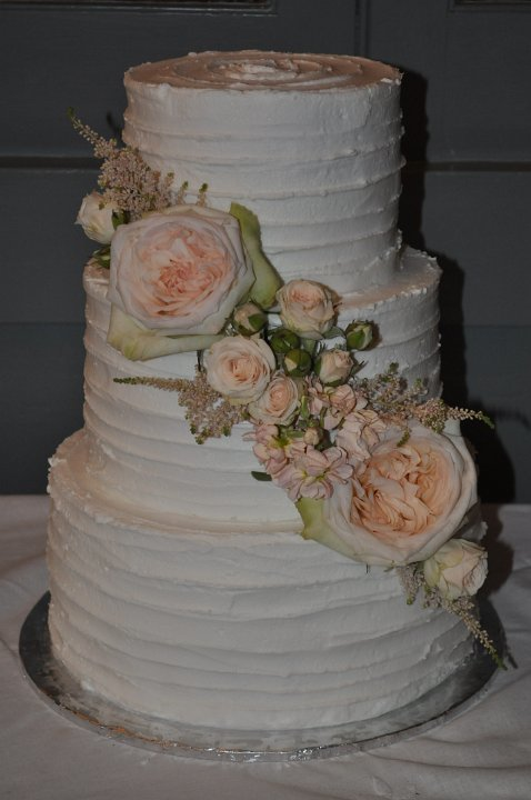 Rustic ivory buttercream with fresh flowers