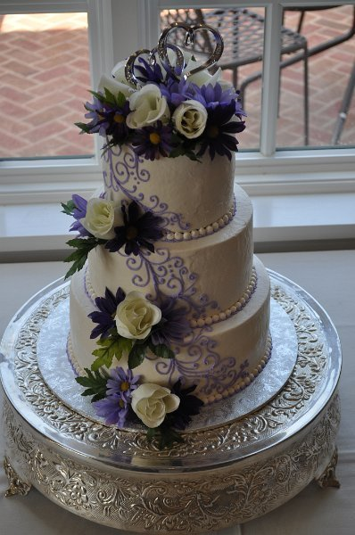 Scrolls and silk flowers and foliage 3 tier