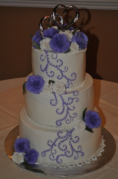 Purple scrolls, sugar roses and carnations
