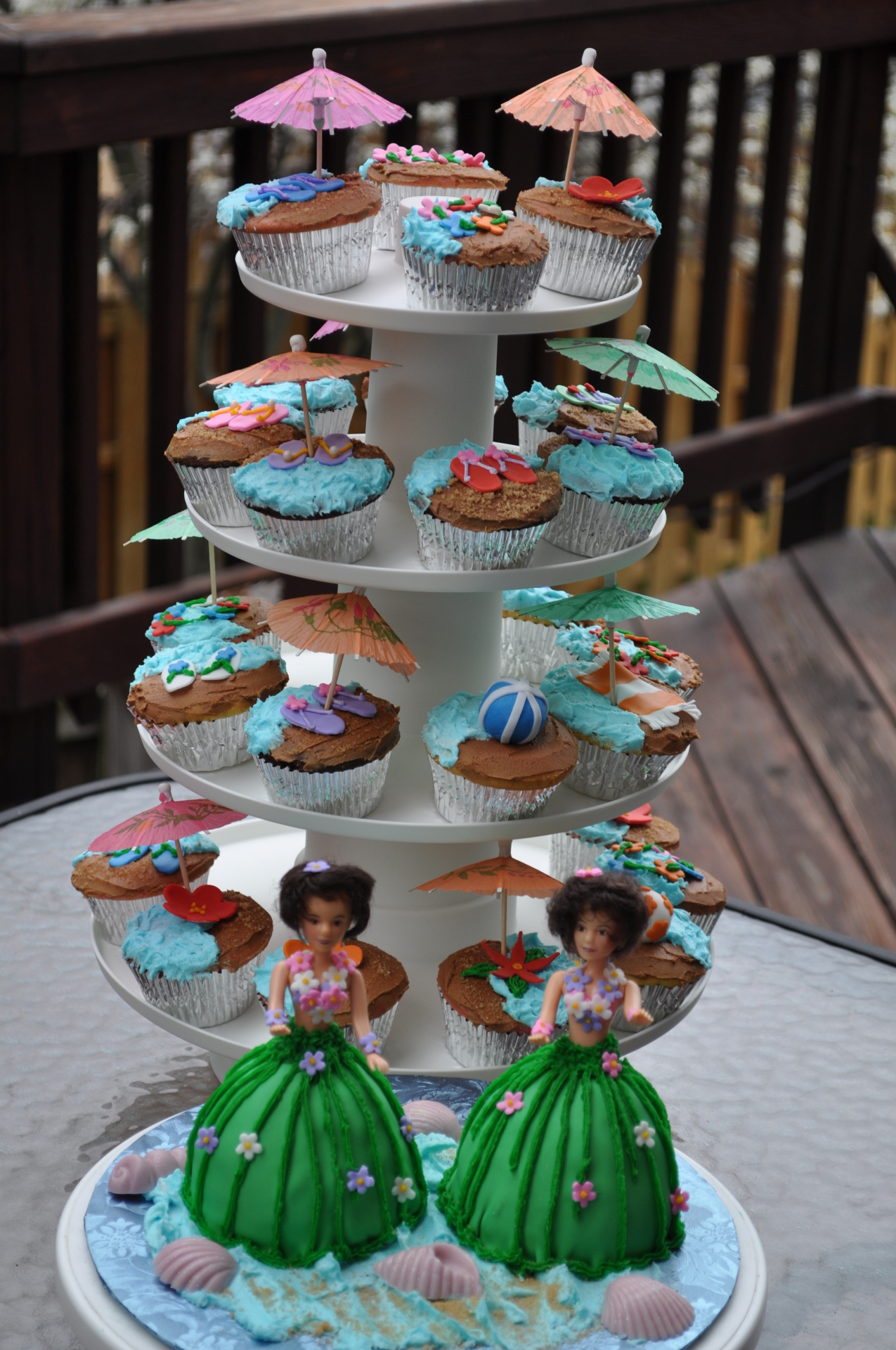 Beach theme cake,Hula doll cake, Hawaiian theme birthday cake,beach cupcakes,umbrella cupcakes