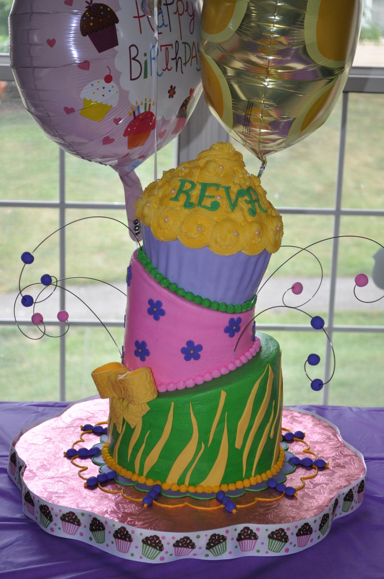 Topsy turvy cake, whimsical cake, giant /jumbo cupcake