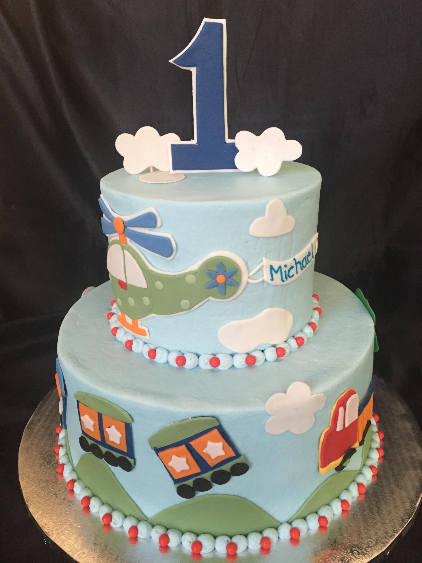1st birthday cake, train cars plane cake