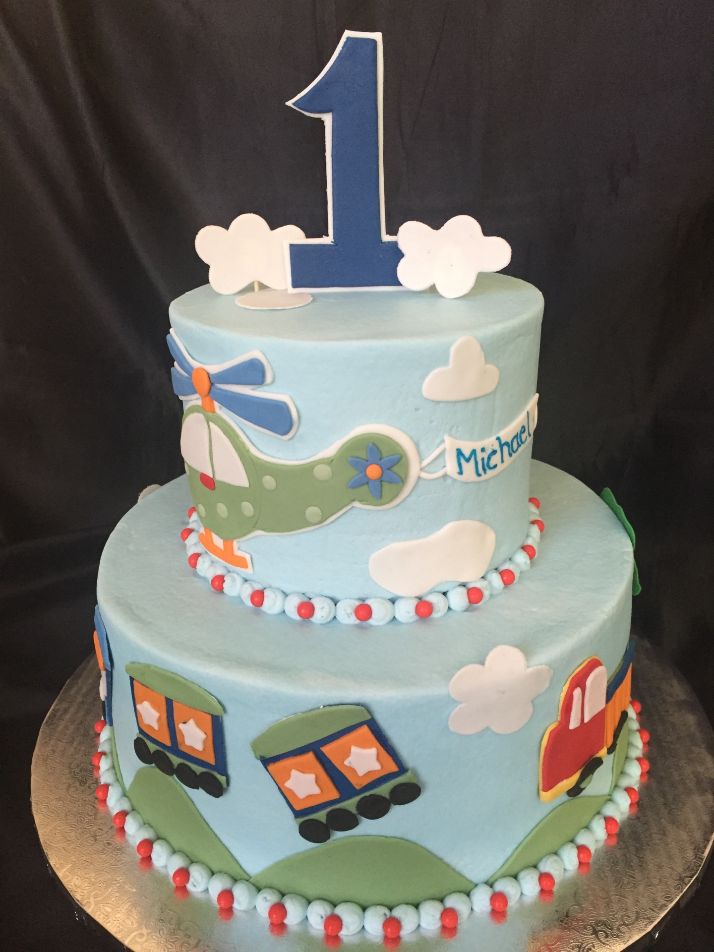 1st birthday cake, train cars plane cake