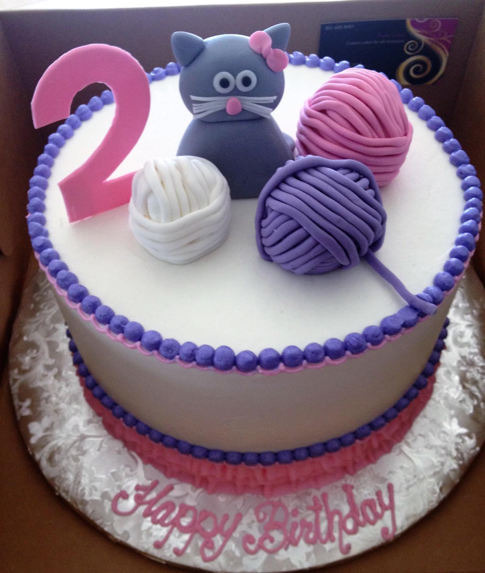 Knitting , yarn balls, kitten cake