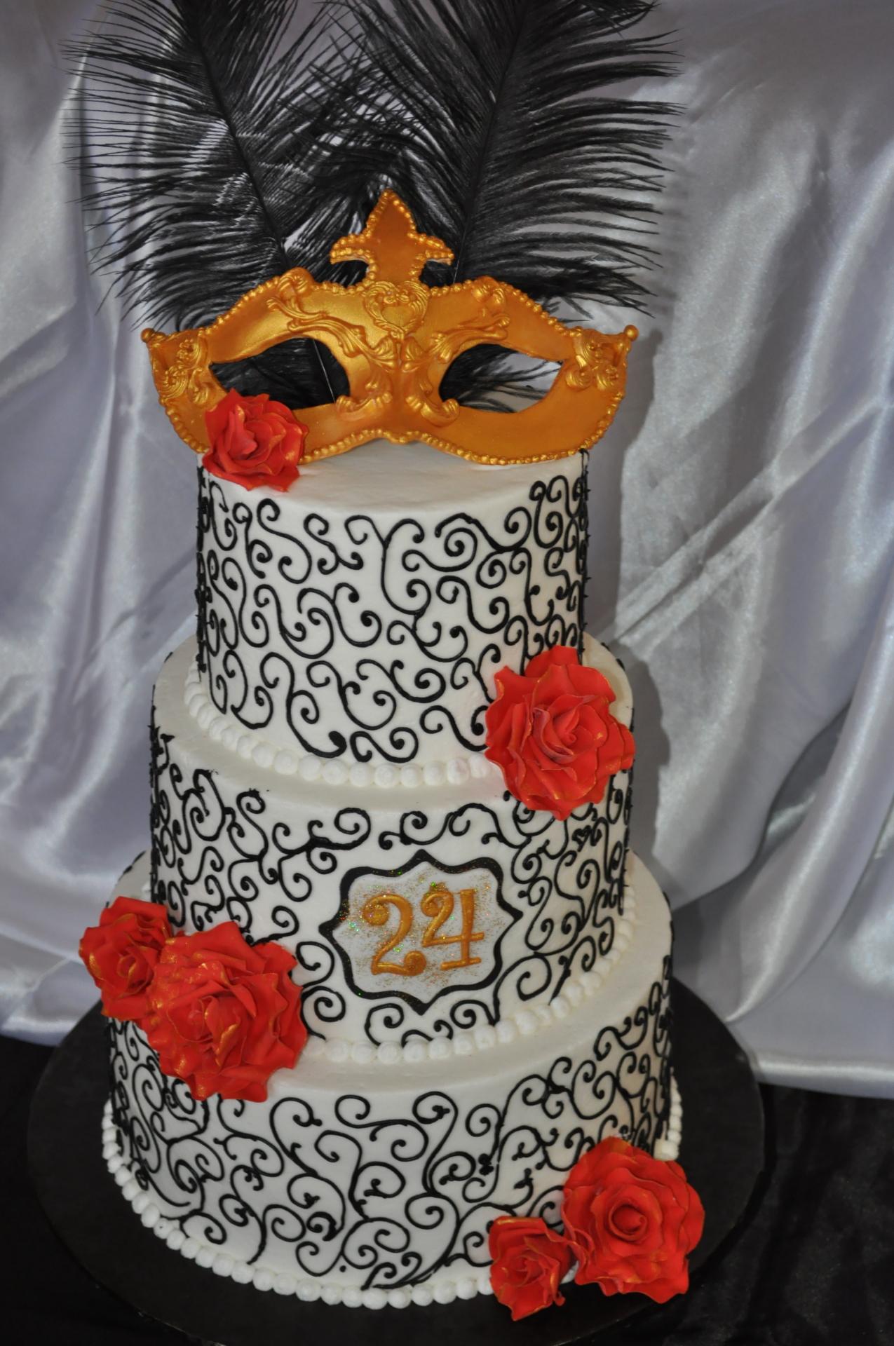 Gold mask black scrolls feathers cake