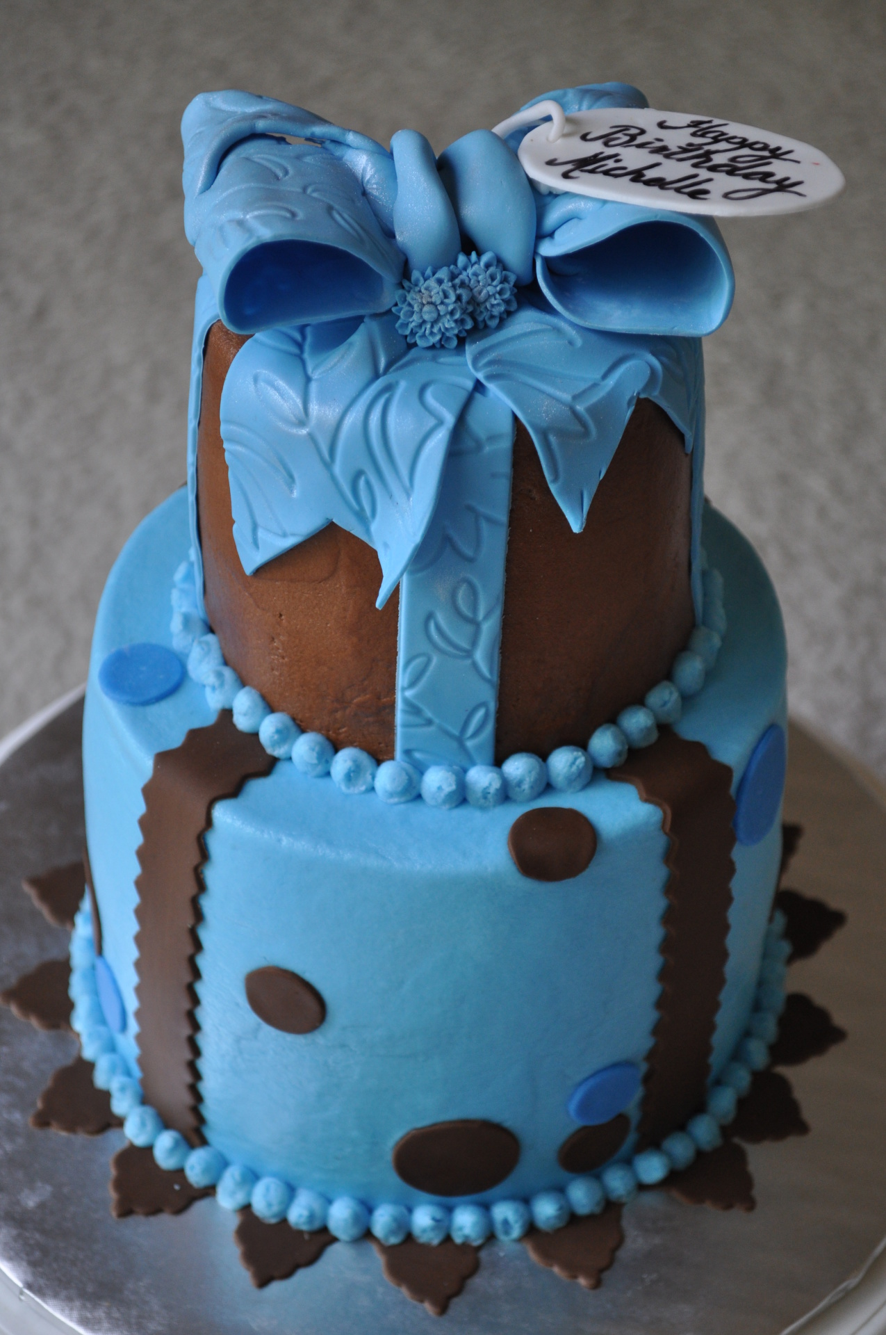 Blue and brown birthday cake,bow cake