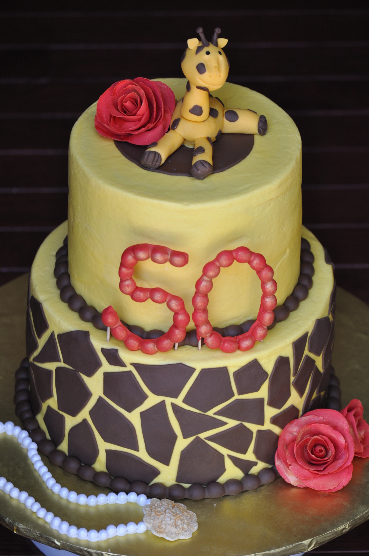 Giraffe print 50th birthday cake