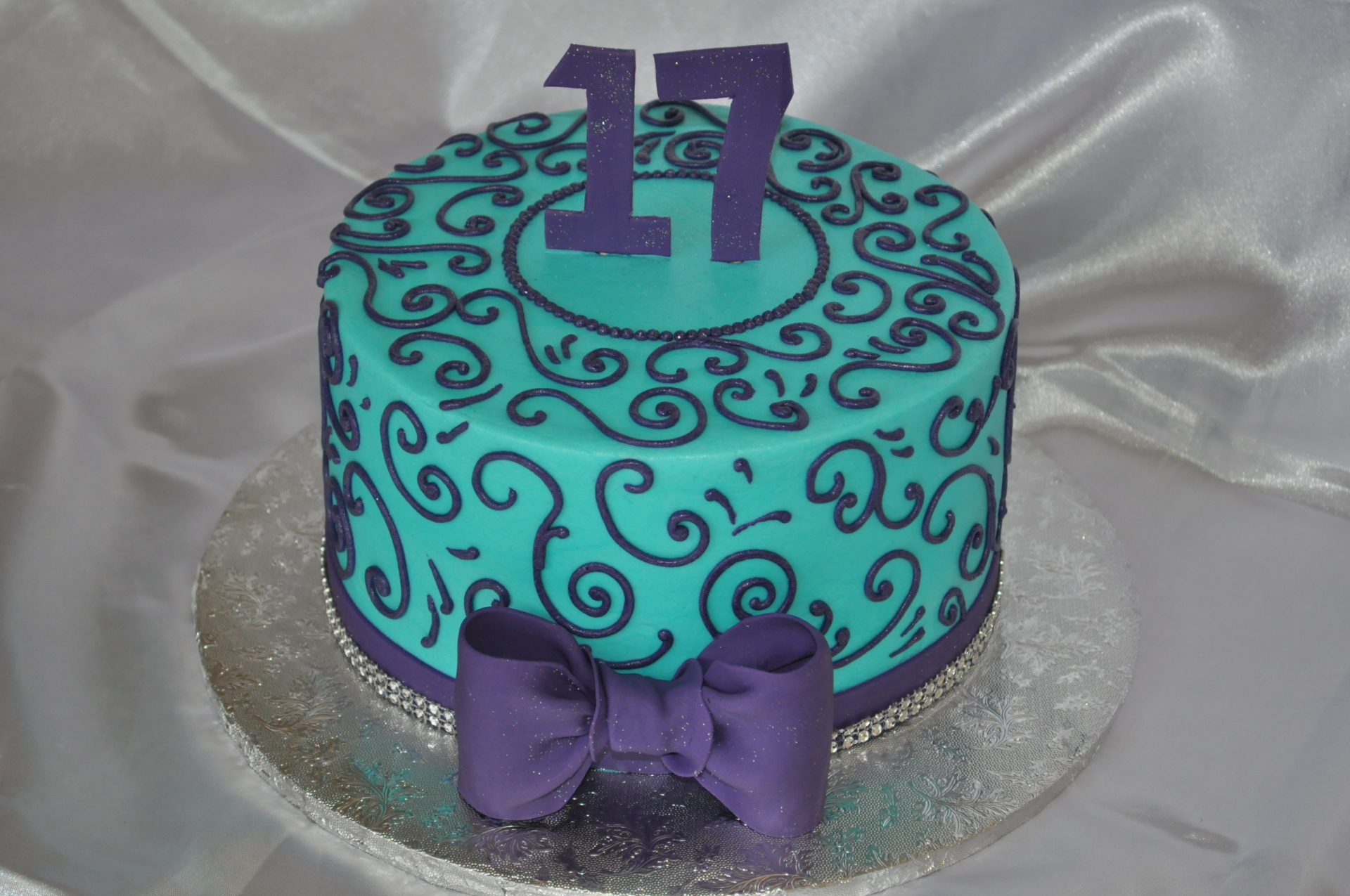 Purple and teal scrolls birthday cake