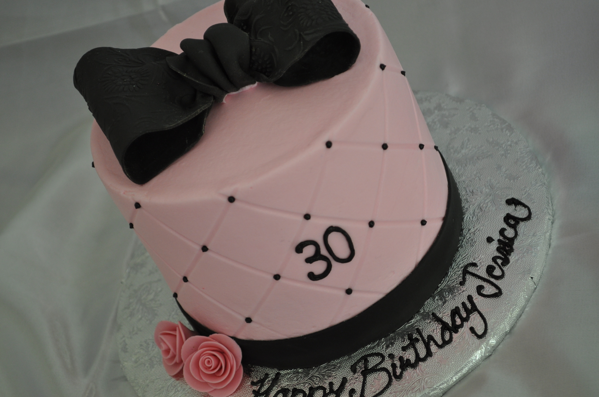Black bow pink birthday cake