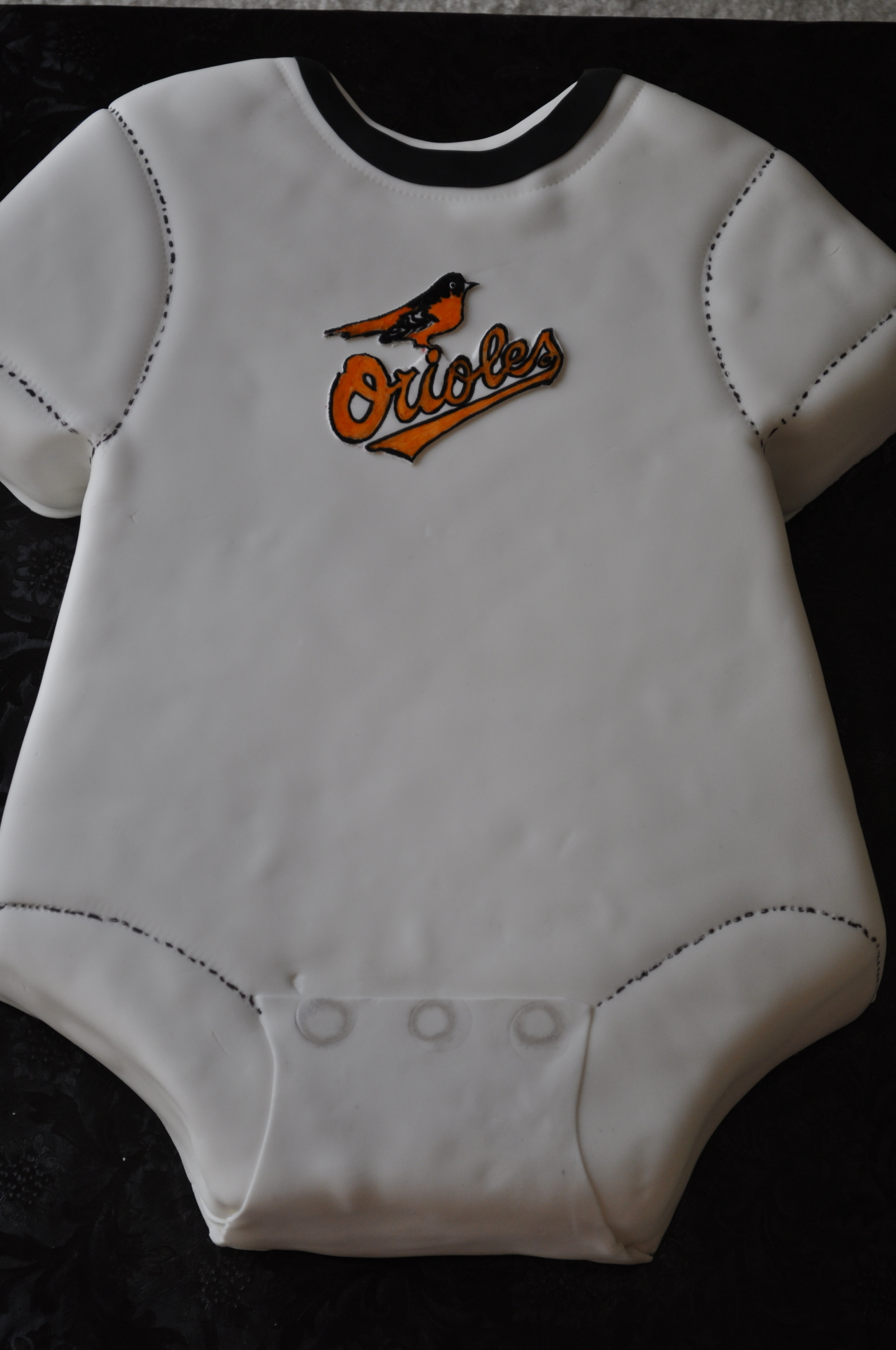 Onesie baby shower cake