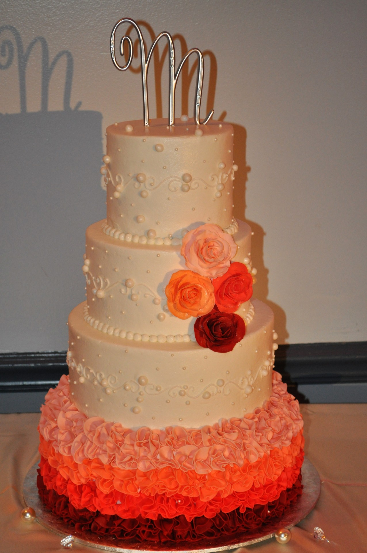 Peach Maroon fondant ruffles with sugar roses