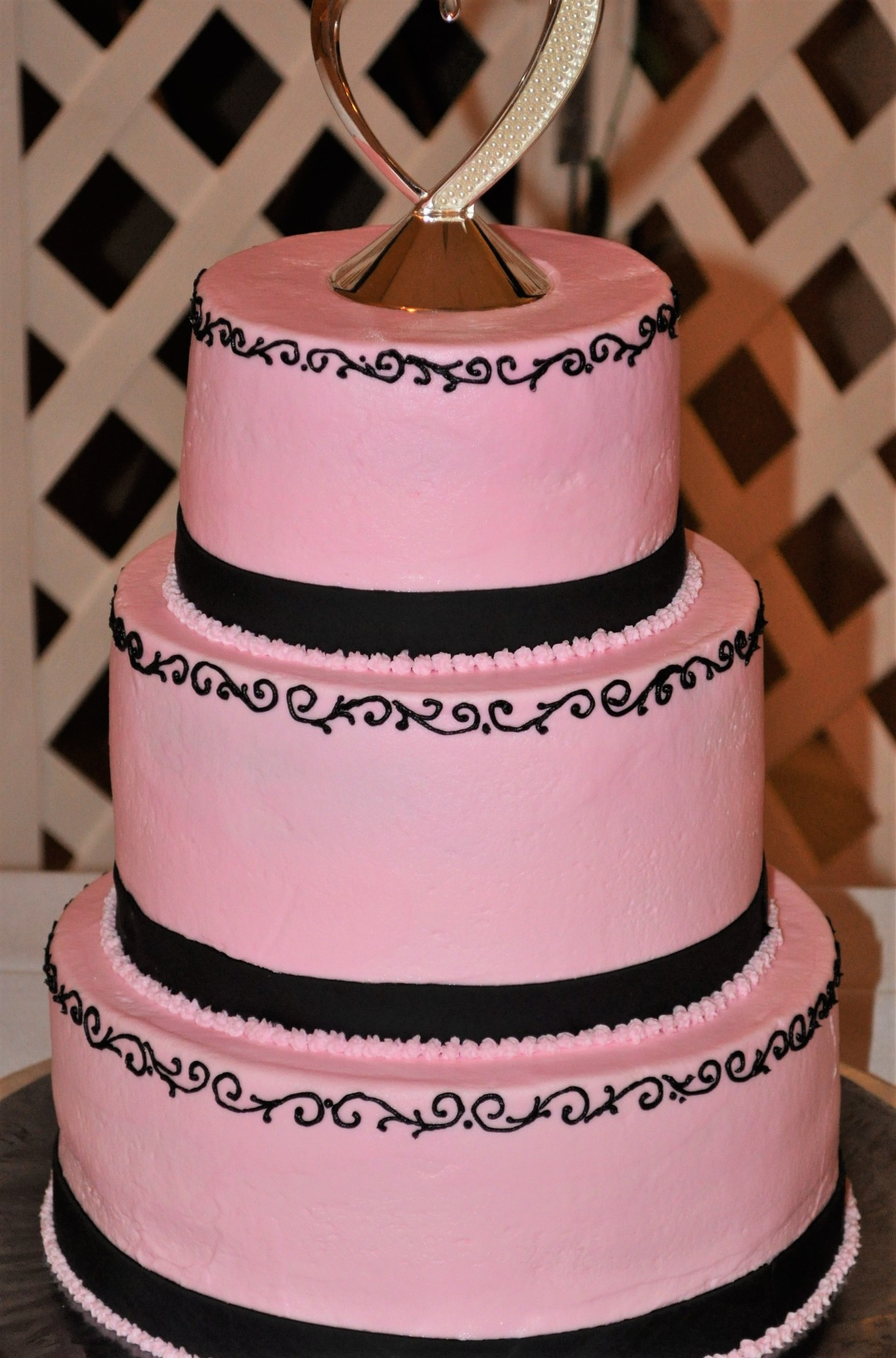 Pink buttercream black scrolls