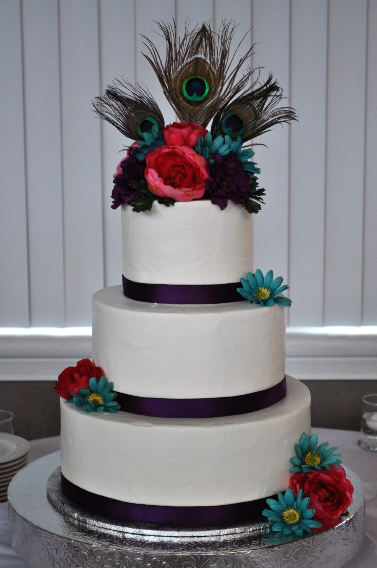 Peacock feathers and flower topper