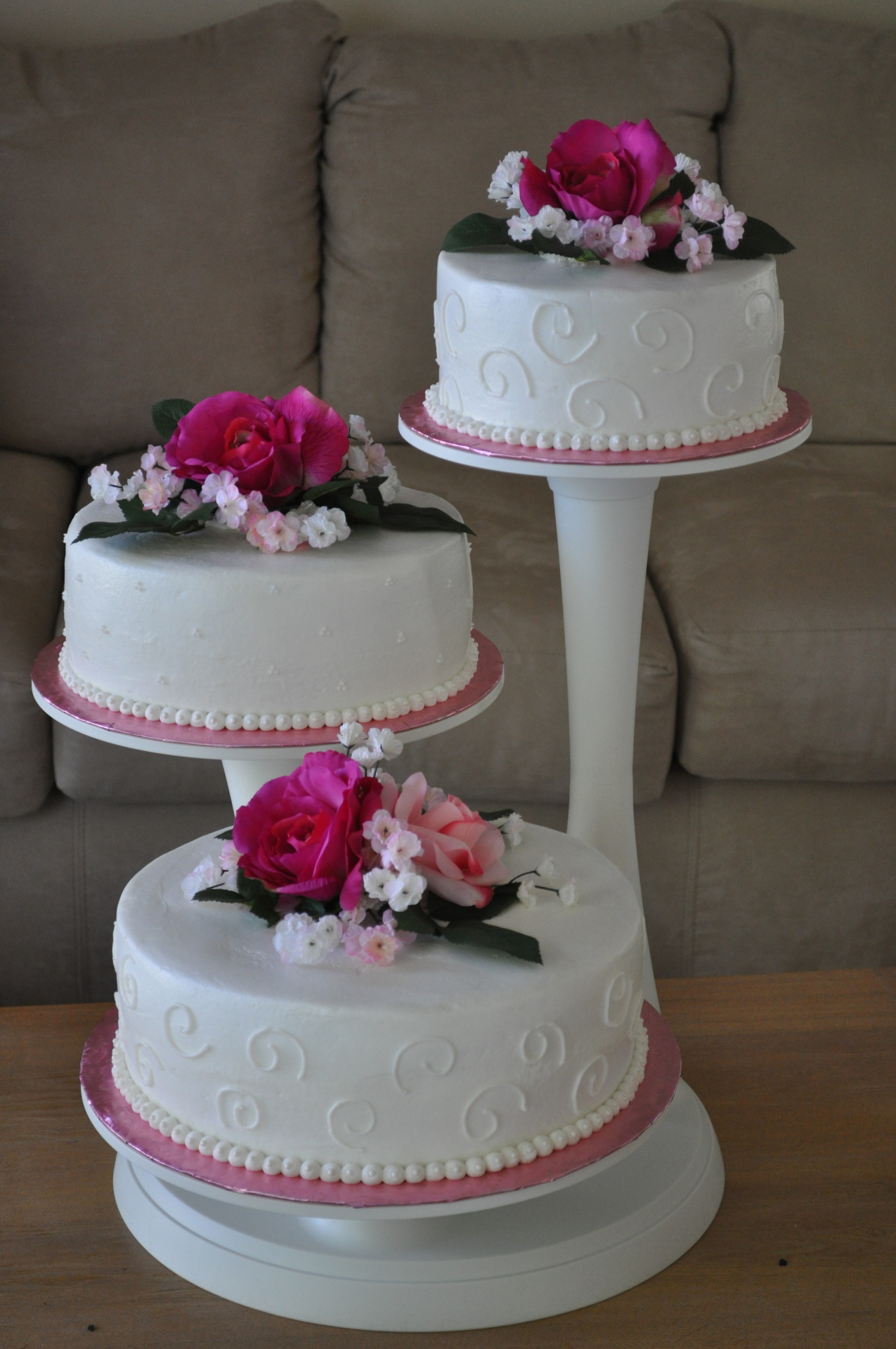 3 Cascading tiers with pink silk flowers