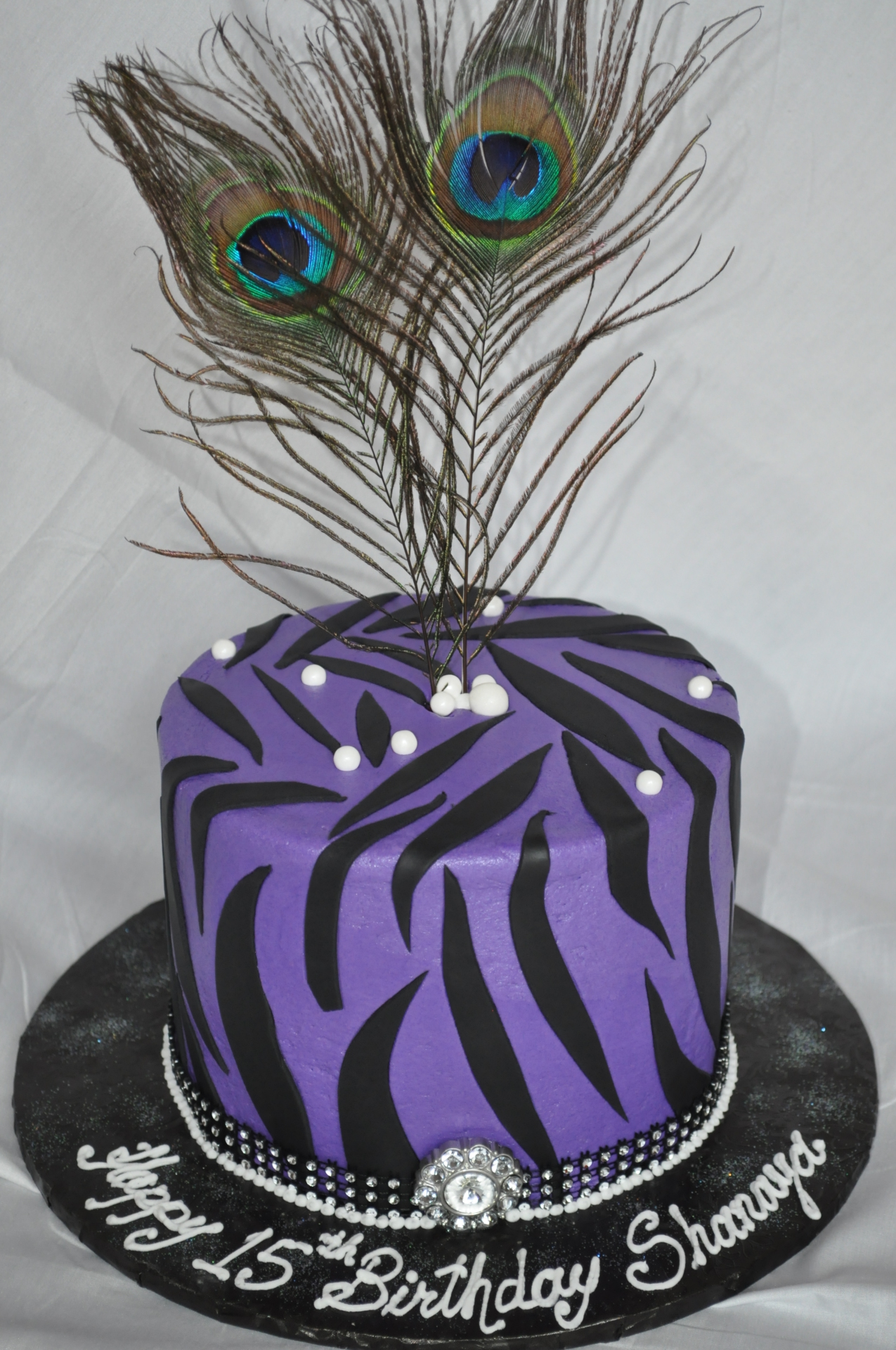 Purple zebra stripes with peacock feather