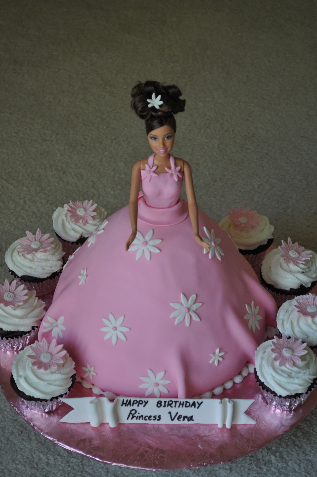 Barbie doll cake with cupcakes