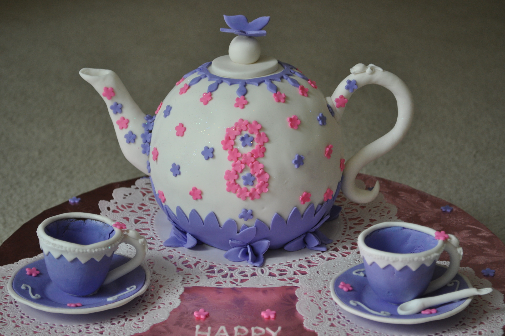 Tea party kettle with fondant cup and saucers