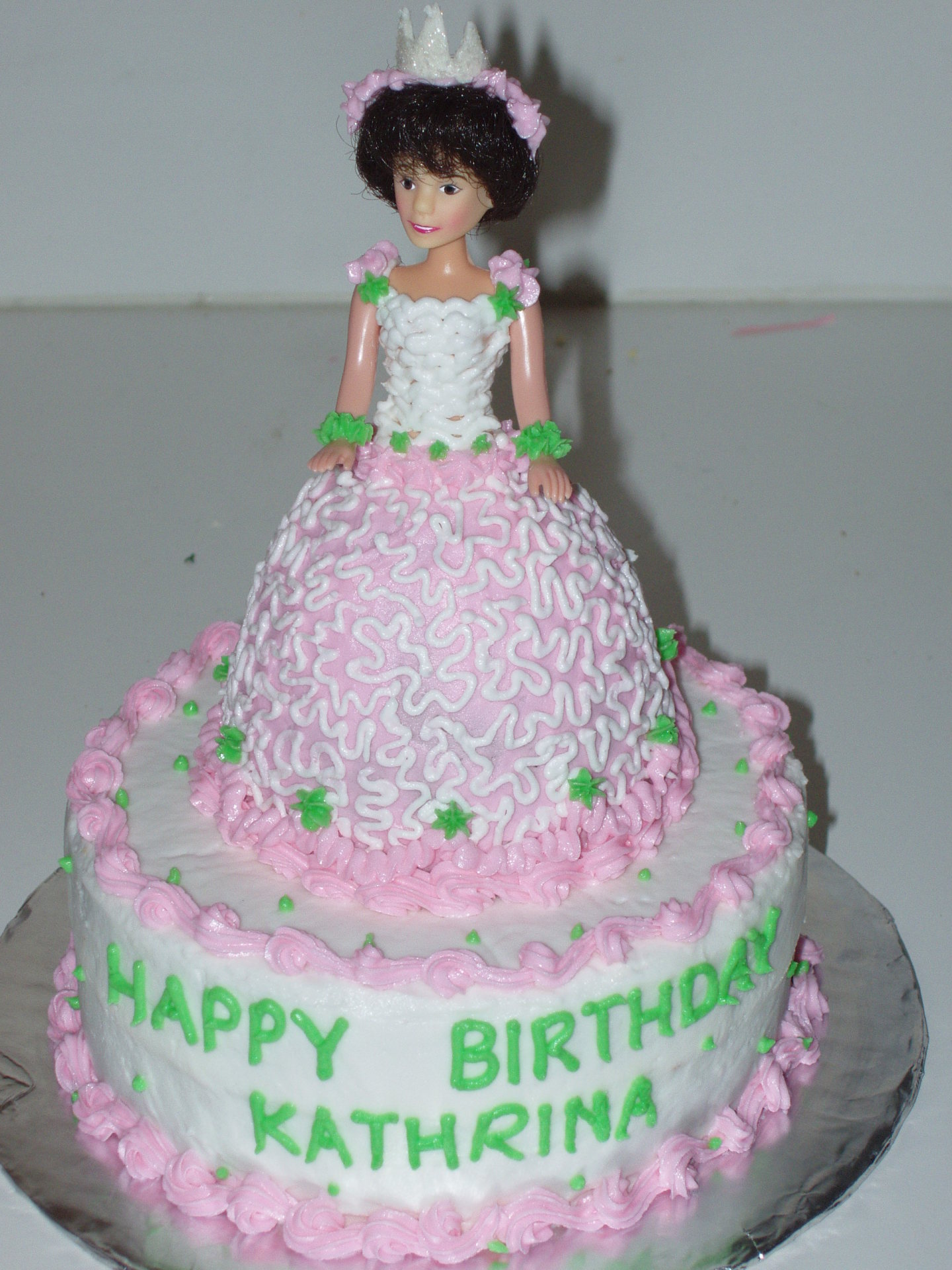 Simple doll cake on the round cake.